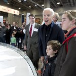 John O'Donnell, executive vice president, Washington Area New Automobile Dealers Association observes the vice president's reaction as he looks at the 2015 Corvette.
