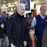 Vice President Joe Biden and auto show chairman Kevin Reilly make their way through the crowd.