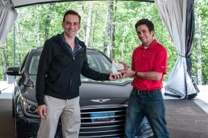 Ariel Garcia-Linares and Logan Utsman with 2015 Hyundai Genesis winner of the Top Family Choice award.