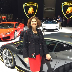 Barbara Pomerance, ceo, Pomerance & Associates graces a Lamborghini.